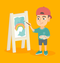 Caucasian boy artist painting picture on a canvas vector