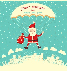 Santa Claus on parachute flying in winter blue sky vector image vector image