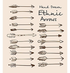 Set of ethnic arrows hand-drawn on a beige vector