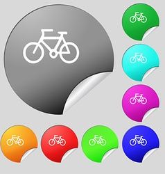 Bicycle icon sign Set of eight multi colored round vector image