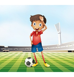 A male soccer player at the field vector