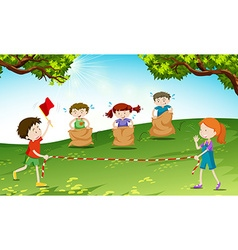 Children play jumping sack in the park vector
