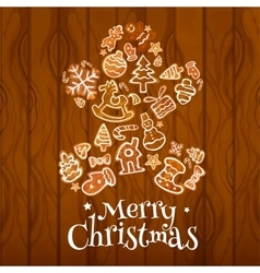 Christmas gingerbread man on wooden background vector