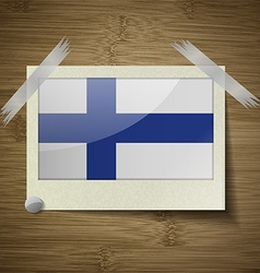 Flags finland at frame on wooden texture vector