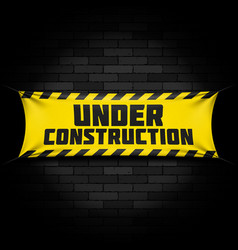 under construction banner on black vector image vector image