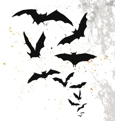 Halloween background with flying bats vector