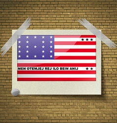 Flags bikini atoll at frame on a brick background vector