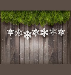 Christmas decoration on old wooden background vector
