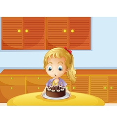 A girl blowing her cake vector image