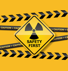 Radiation warning sign on yellow wall vector