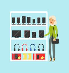 Young blond woman choosing digital tablet at vector