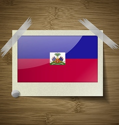 Flags haiti at frame on wooden texture vector