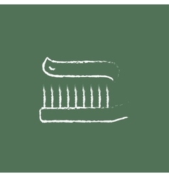Toothbrush with toothpaste icon drawn in chalk vector