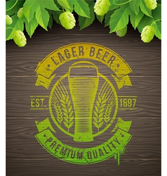 Beer emblem and ripe hops vector image