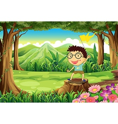 A boy above the stump holding a yellow banner vector image vector image