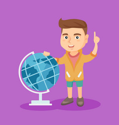 boy standing near globe and pointing finger up vector image