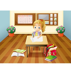 A girl at the desk vector