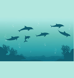 Silhouette of family dophin on sea landscape vector