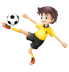 A boy kicking the soccer ball vector image vector image