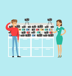Young man choosing camera with shop assistant help vector