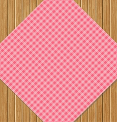 Pink checkered tablecloth on brown oak wooden vector