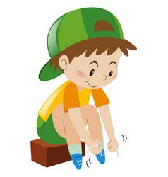 Boy tiding his shoelaces vector