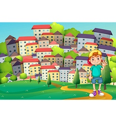 A young boy standing at the hilltop across the vector image
