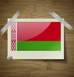Flags belarus at frame on wooden texture vector