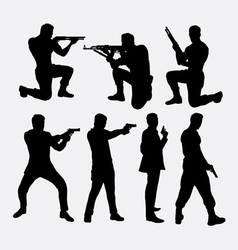Man with gun silhouettes vector