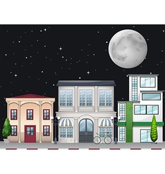 Shops along the street at night vector