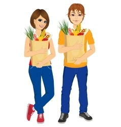 Happy couple carrying grocery paper bags vector