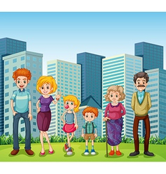A family in front of the tall buildings in the vector image vector image