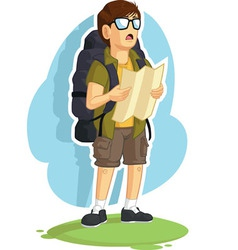 Backpacker boy reading road map vector