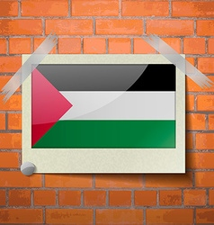 Flags palestine scotch taped to a red brick wall vector