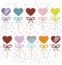 Colorful sweet cake pops hearts set with bow vector