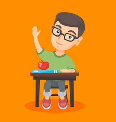schoolboy sitting at the desk with raised hand vector image vector image