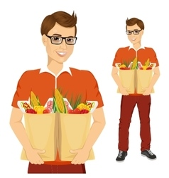 Young man carrying grocery paper bags vector