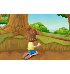 A young girl playing at the ground in the forest vector
