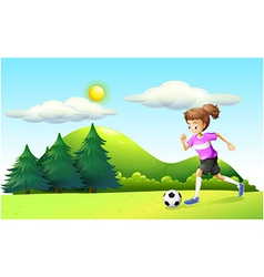A girl playing soccer vector