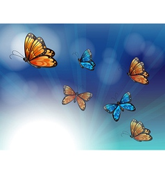 Colorful butterflies in a gradient colored vector image