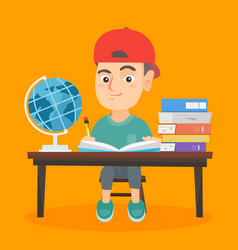 boy sitting at the desk and writing in notebook vector image