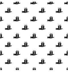 Gift box in hand pattern vector