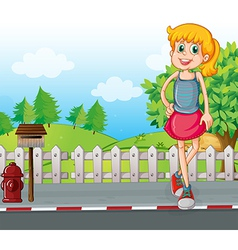 A tall young girl at the street near the mailbox vector image vector image
