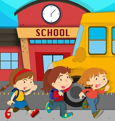 Children running in front of school vector image