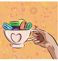 Cup with different macaroons on background vector