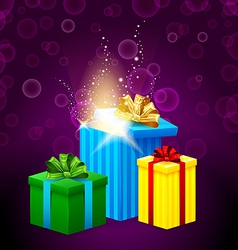 set of gift boxes with beautiful light coming from vector image