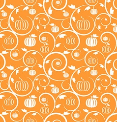 Orange seamless pattern with pumpkin leaves vector