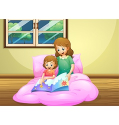 A mother reading with her daughter vector