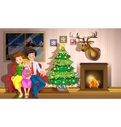 A family inside the room with a christmas tree vector