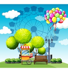 Park with popcorn vendor and balloons vector image vector image